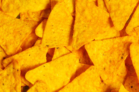 Heap of chips arranged on background photo