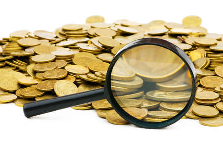 Magnifying glass and lots of gold coins photo