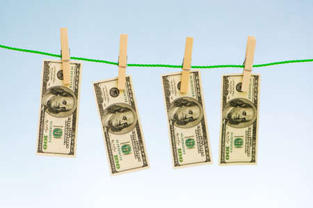 Money laundering concept with dollars on the rope Stock Photo - 5977291