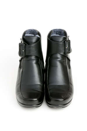 jackboot: Black boots isolated on the white background