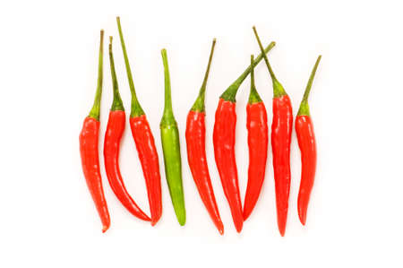 capsaicin: Red chili peppers isolated on the white