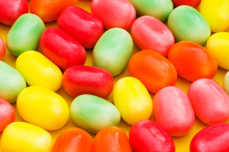 jellybean: Various dry colourful sweets arranged as background