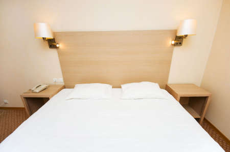 Double bed in the hotel room Stock Photo - 6085673