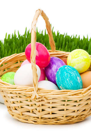 Eggs in the basket and grass isolated on white Stock Photo - 6314081