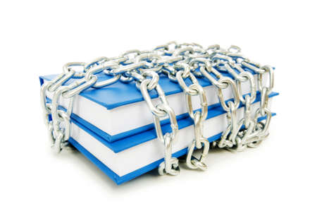 Censorship concept with books and chains on white photo