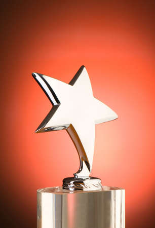 trophies: Star award against red gradient background Stock Photo