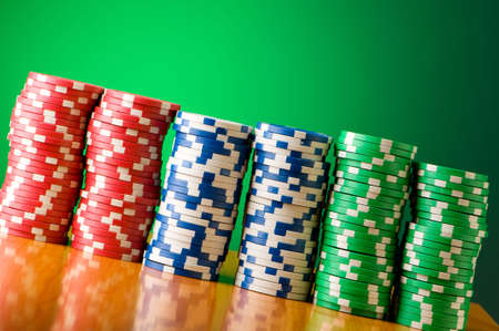 Stack of casino chips against gradient background photo
