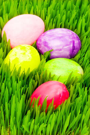Easter concept - colourful eggs in green glass photo