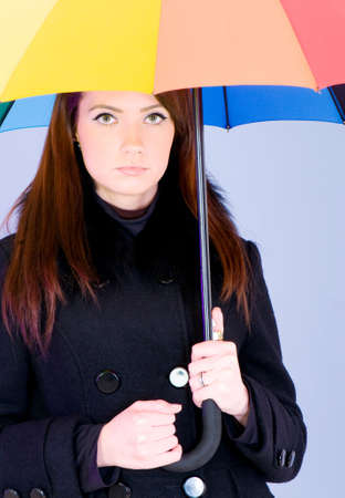 Portrait of young woman with umbrella photo