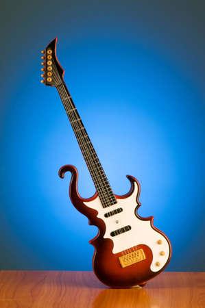 Wood guitar against gradient background photo