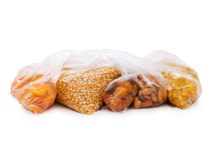 Various dry fruits in the bags on white Stock Photo - 6458301
