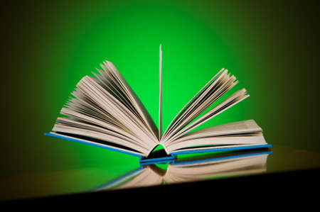 Stack of books against gradient background photo