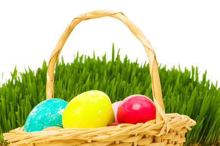 Eggs in the basket and grass isolated on white Stock Photo - 6553716