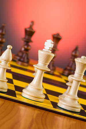 Chess concept with pieces on the board photo