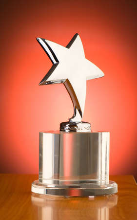 Star award against red gradient background Stock Photo