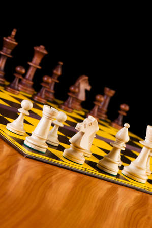Chess concept with pieces on the board Stock Photo - 6623378
