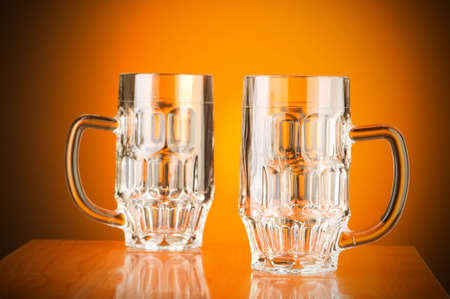 Beer glass against gradient background photo