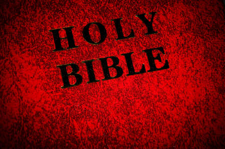 Red leather cover of the Bible book photo