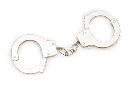 Metal handcuffs isolated on the white background photo