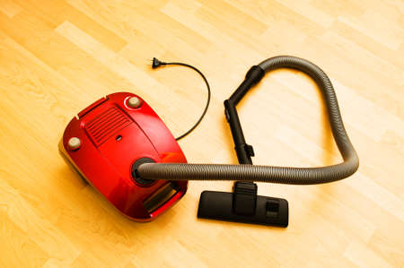 Vacuum cleaner on the wooden floor Stock Photo - 6850745