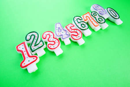 Birthday candles against colourful background photo