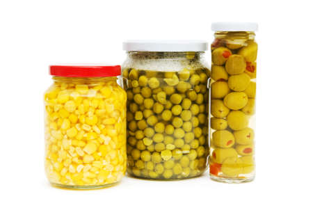 Various pickles in the glass jars on white Stock Photo - 6923943