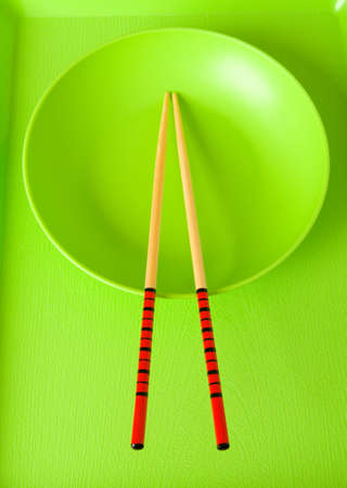 Asian food concept with plate and chopsticks photo