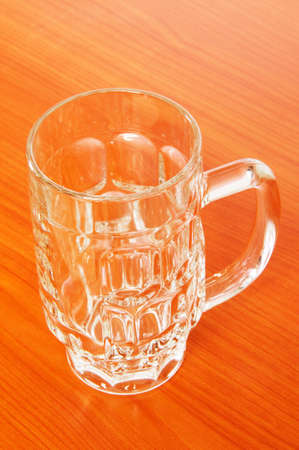 Beer glass on the wooden table Stock Photo - 6924275