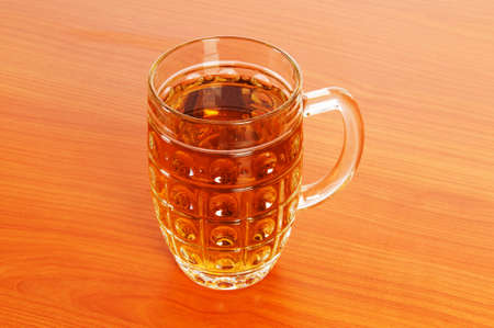 Beer glass on the wooden table Stock Photo - 6924270