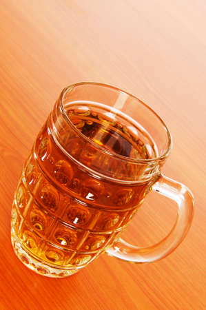 Beer glass on the wooden table Stock Photo - 6986846