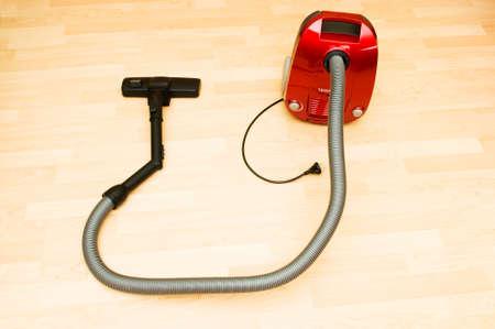 Vacuum cleaner on the wooden floor Stock Photo - 6992066