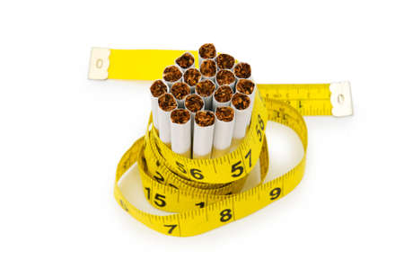 quiting: Smoking concept with measuring tape and cigarettes Stock Photo