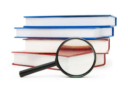 Magnifying glass over the stack of books Stock Photo - 7045707