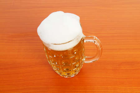 Beer glass on the wooden table Stock Photo - 7045822