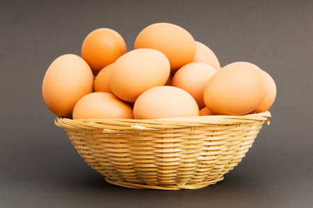 Basket of eggs on the colourful background Stock Photo - 7045820