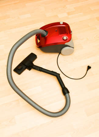 Vacuum cleaner on the wooden floor Stock Photo - 7084609