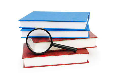 magnifier: Magnifying glass over the stack of books  Stock Photo