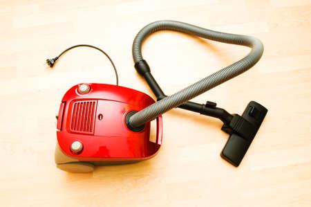 Vacuum cleaner on the wooden floor Stock Photo - 7189704