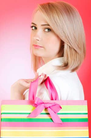 Blond girl with shopping bag  Stock Photo - 7228391