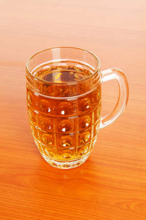 Beer glass on the wooden table Stock Photo - 7229060