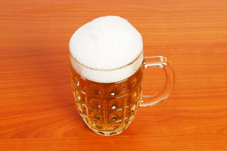Beer glass on the wooden table Stock Photo - 7229008