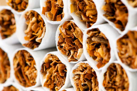 quiting: Close up of smoking cigarettes as antismoking concept Stock Photo