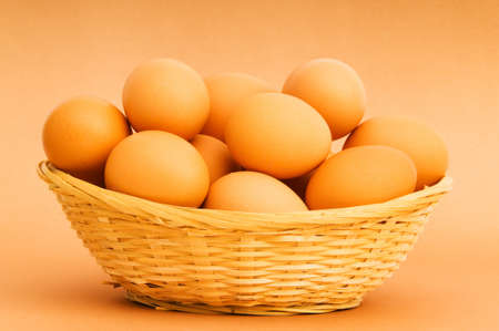 Basket of eggs on the colourful background photo