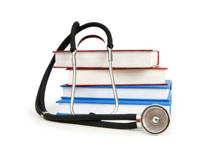 practitioner: Concept of medical education with book and stethoscope