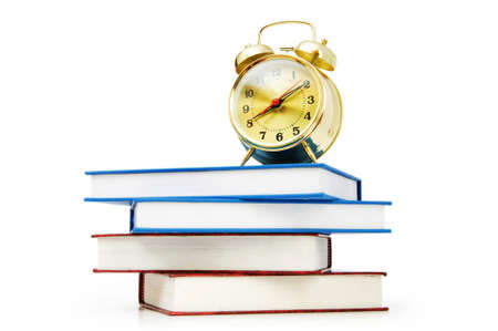 Back to school concept with books and clock Stock Photo - 7228821