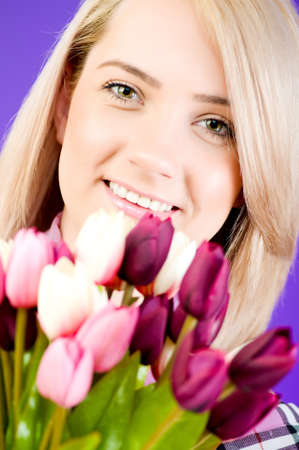 Blond girl with flowers photo