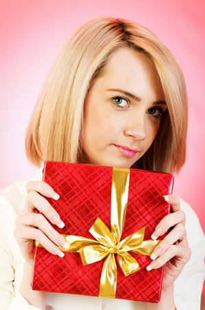 Young woman with red gift box  photo