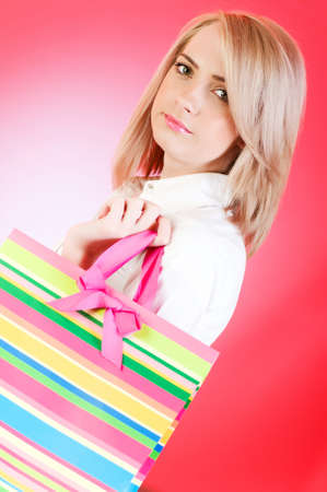 Blond girl with shopping bag  photo