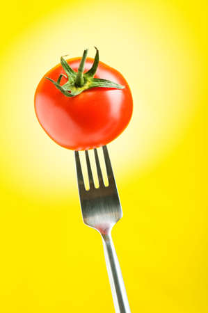 Red tomato against gradient background photo