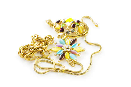 armlet: Golden chain and brooch isolated on white